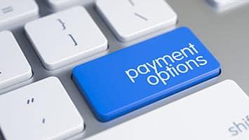 """touche d'un clavier d'ordinateur avec une touche bleue """"Payment options"""""""